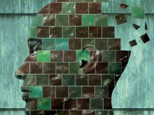 Obraz przedstawiający ludzką głowę w formie mozaiki